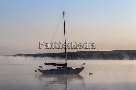 a sailboat is moored on the