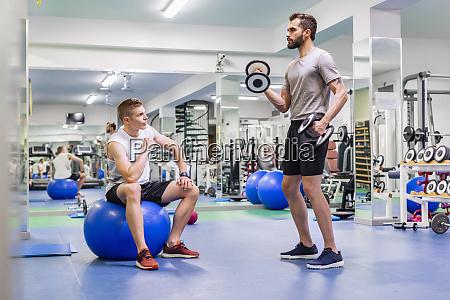 man, coaching, friend, in, gym - 28124026
