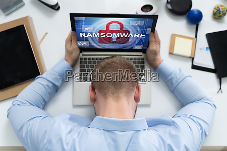 sad man with laptop infected by