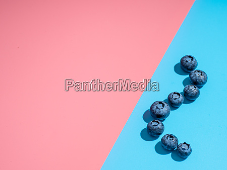 blueberry on pink and blue background