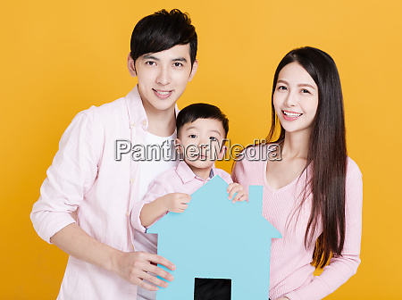 young family hands holding paper