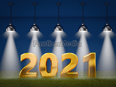 2021 on a grass with spotlights