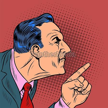 wuetender mann zeigt mit dem finger