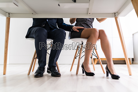 man touching womans thigh