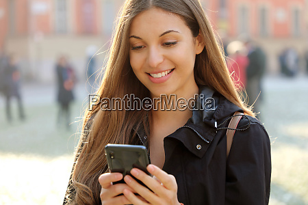 attractive beautiful young woman using smart