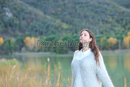 teenage girl breathing fresh air on