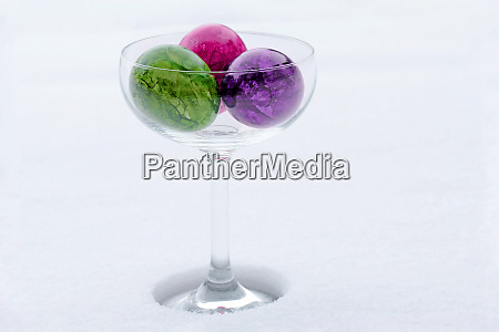three colorful easter eggs in a