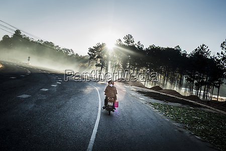 rear view of motorbike driving along