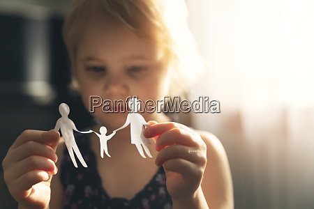 little girl with paper family in