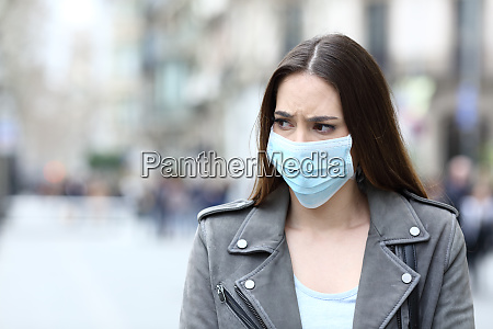 scared woman with protective mask avoiding