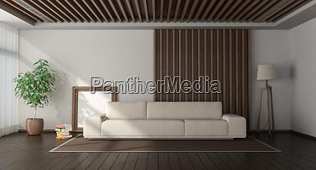 minimalistisches wohnzimmer mit holzvertaefelung auf dem