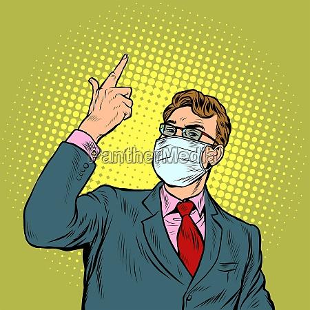 geschaeftsmann in einer medizinischen maske die