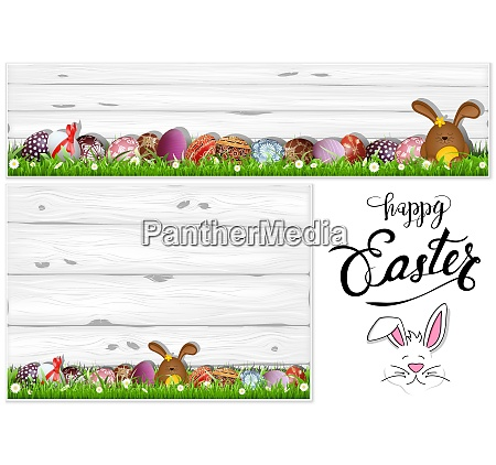 easter eggs on grass and wooden