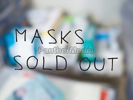 masken ausverkauft zeichen verschwommenen apothekenhintergrund
