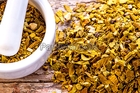 mistletoe medicinal herb dried with mortar