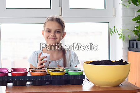 girl with bags of seeds and