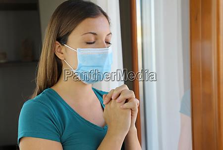 covid 19 pandemic coronavirus woman praying