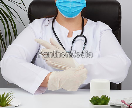 woman doctor in a white uniform