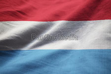 nahaufnahme der rueschen luxemburger flagge luxemburgische