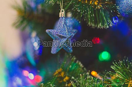 blauer stern weihnachtsbaum spielzeug