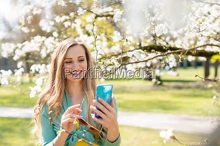 young woman using her phone on