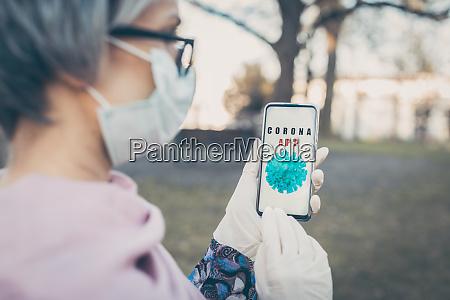 senior woman using phone to get