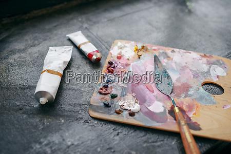colorful paints on palette closeup nobody
