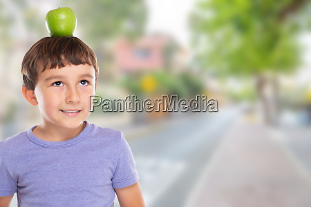 young boy child with an apple