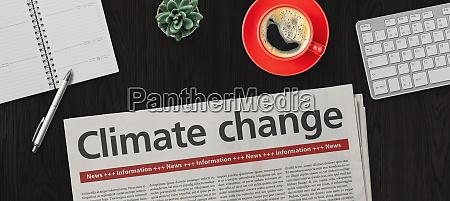 zeitung auf dem schreibtisch klimawandel