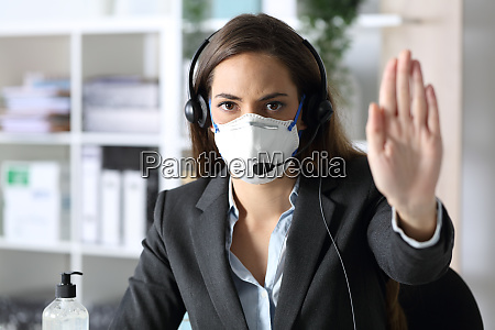 serious telemarketer gesturing stop avoiding covid