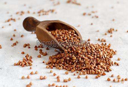 raw dry buckwheat grain with a