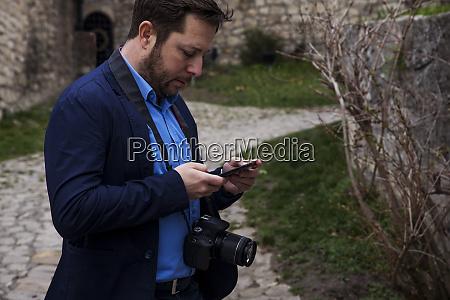 fotograf im freien UEbertragen von fotos