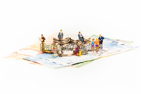 miniature people and coins on top