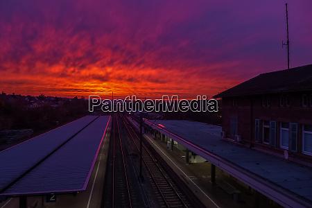 a colorful sundown above a small