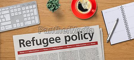 zeitung auf dem schreibtisch fluechtlingspolitik