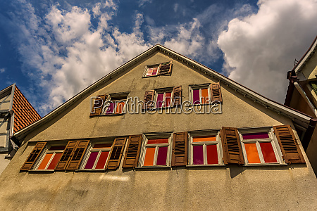 an old building with modern colors
