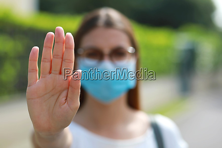 stop covid 19 unidentified woman wearing