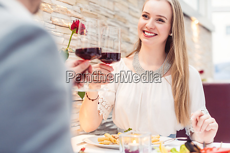 couple toasting with red wine in