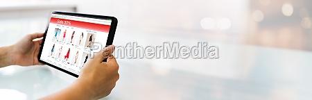 frau shopping online auf tablet
