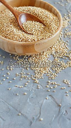 raw dry white quinoa seeds close