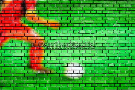 fussball hintergrund auf einer ziegelwand gemalt