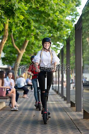 trendy fashinable teenager girls riding public