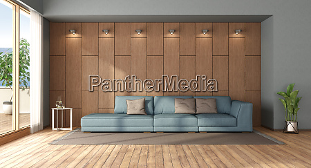 wohnzimmer mit sofa gegen holzverkleidung