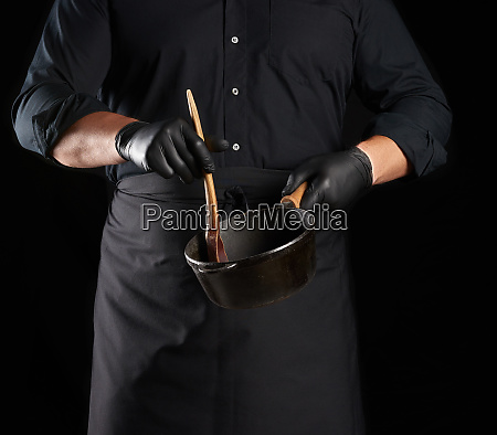 male cook in black uniform and
