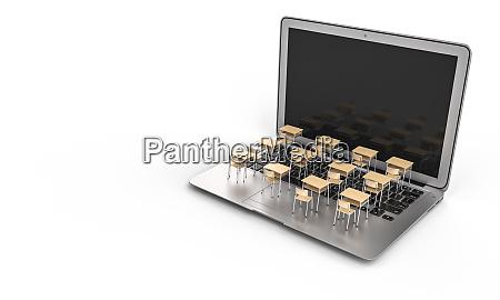 schulpulte auf einer laptop tastatur fernunterrichtskonzept
