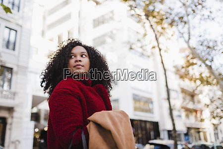 young woman looking over shoulder on