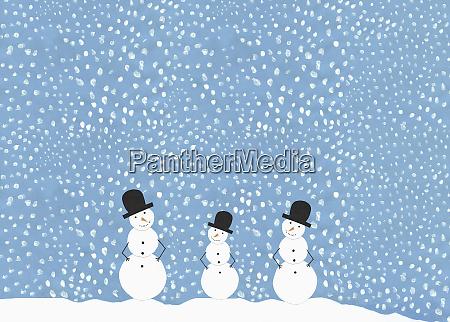 illustration laechelnde schneemaenner gegen schneebedeckten himmel
