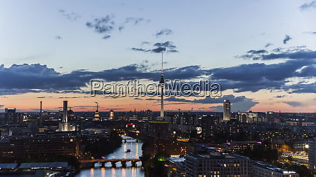 television tower and berlin cityscape illuminated