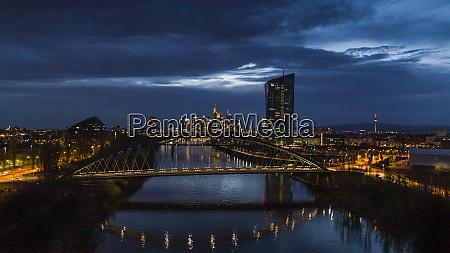 illuminated frankfurt cityscape and osthafenbruecke bridge