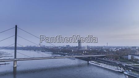 rhine knee bridge and duesseldorf cityscape